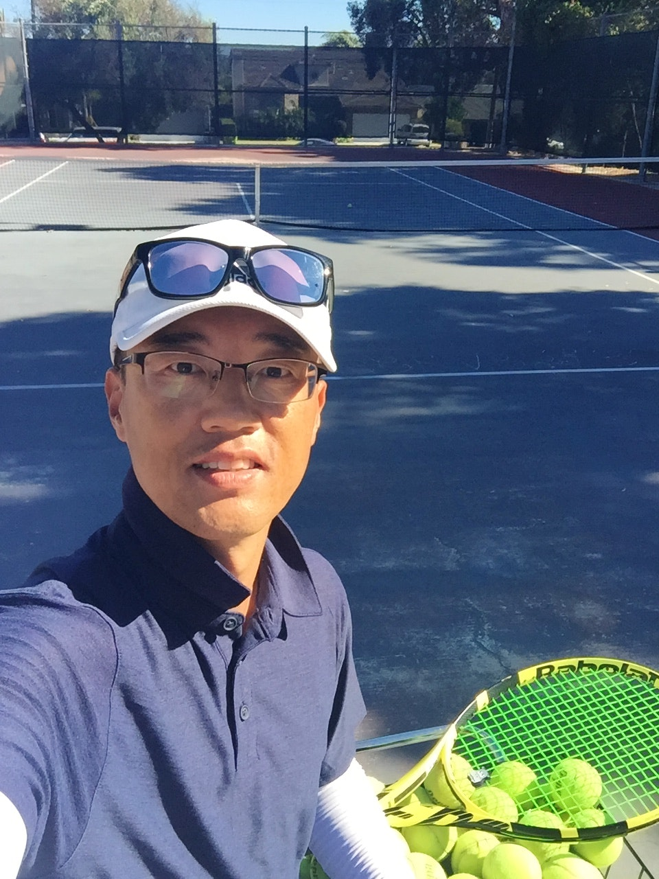 Yitae (. teaches tennis lessons in Torrance , CA