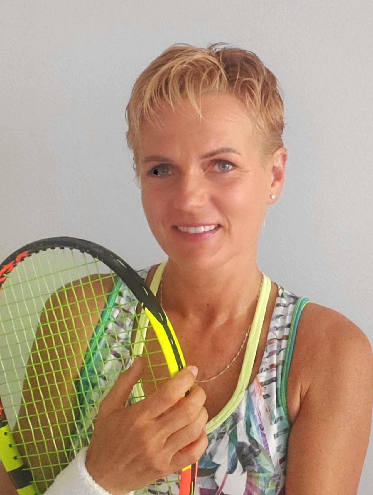 Edyta W. teaches tennis lessons in Palm Coast, FL