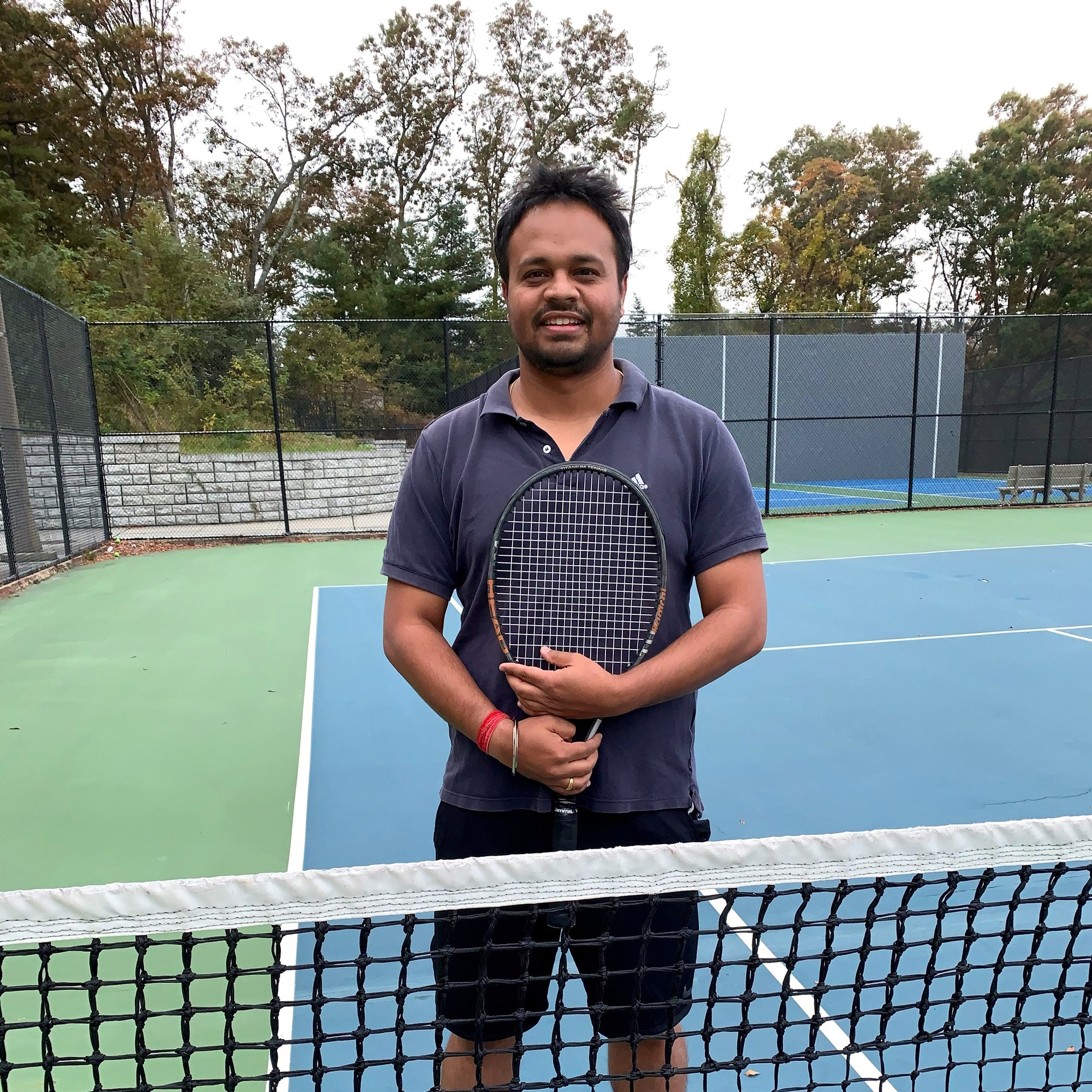 Prasurjya B. teaches tennis lessons in Hicksville, NY