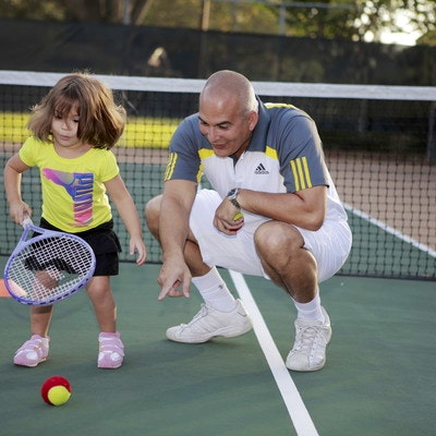 Marcus M. teaches tennis lessons in Orlando , FL