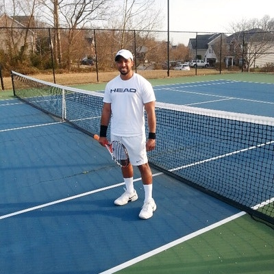 Edwin M. teaches tennis lessons in Winston Salem , NC