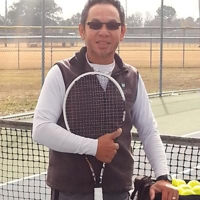 Toy T. teaches tennis lessons in Fleming Island, FL