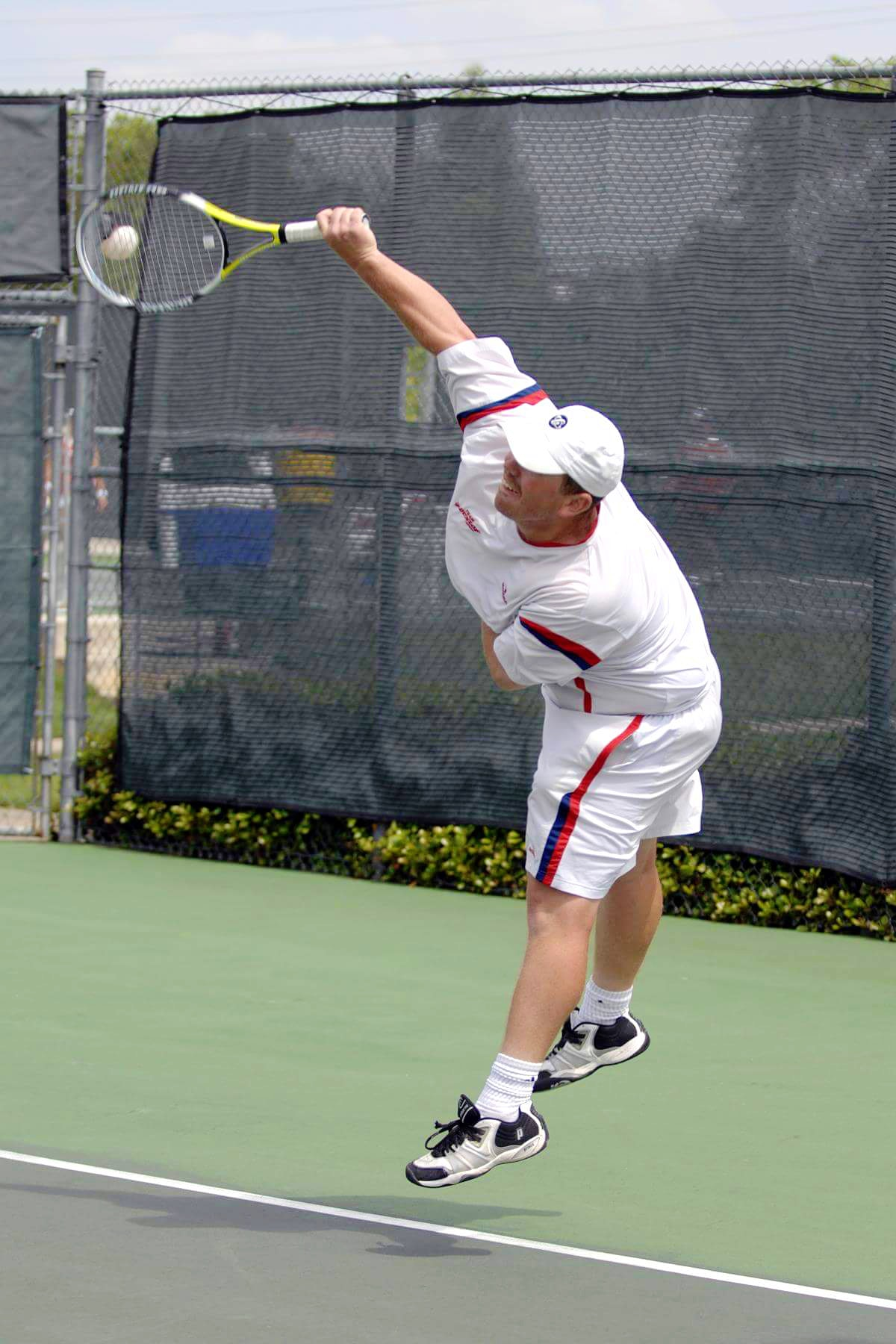 Greg Z. teaches tennis lessons in Magnolia , TX